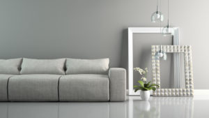 Part of  interior with grey sofa and stylish frames 3D rendering